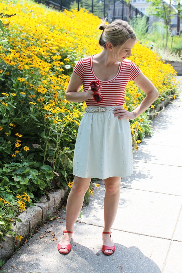 Poor Little It Girl in Madewell Red Striped T-shirt, Warehouse White Leather Skirt and Madewell Red Sandals with Red Heart-Shaped Sunnglasses
