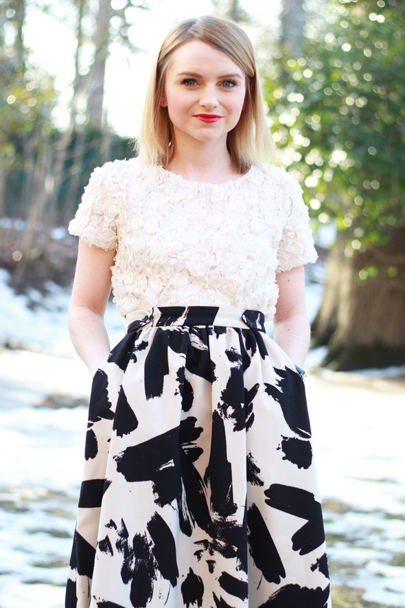 Poor Little It Girl in Anthropologie Blossom Top and H&M Printed Midi Skirt