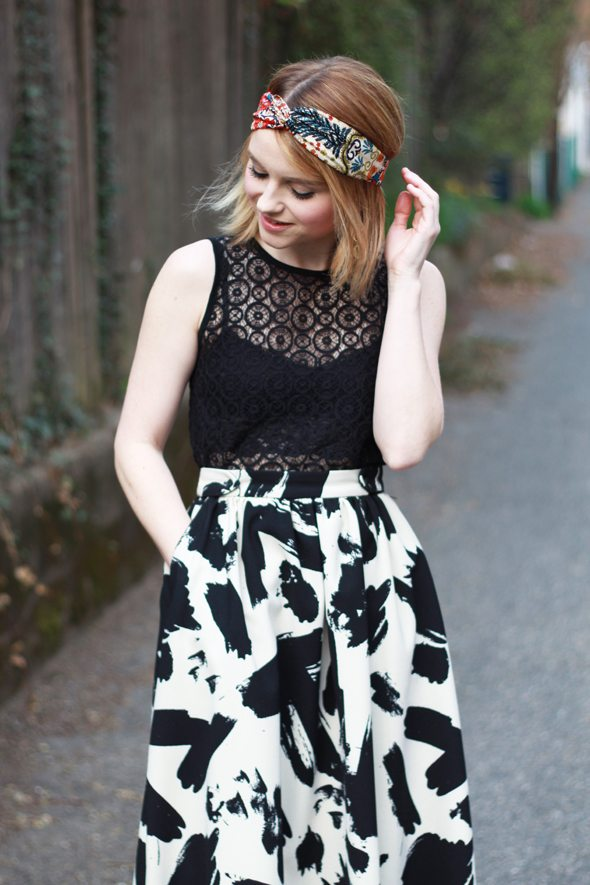 Poor Little It Girl - H&M Printed Midi Skirt, Madewell Black Lace Top, Anthropologie Headband Turban and Elizabeth & James Orange Heels