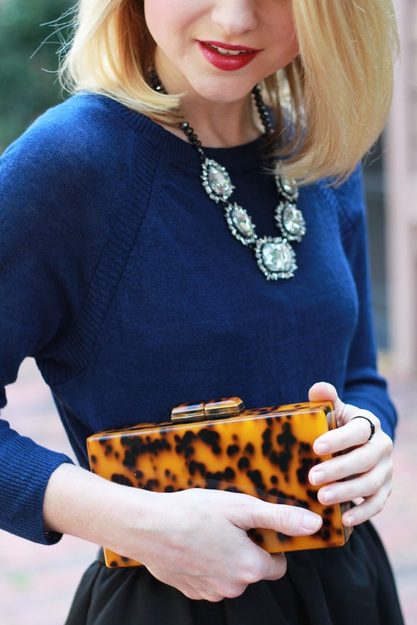 Poor Little It Girl - J.Crew Navy Sweater, Express Black Midi Skirt, Design Darling Tortoise Clutch and ASOS Metallic Heels